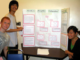 Biology Students Giving Poster Session